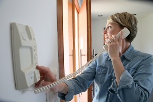 Woman inside home answering intercom